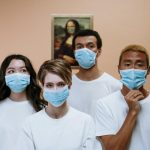 A group of people wearing masks (From:pexels.com by cottonbro)