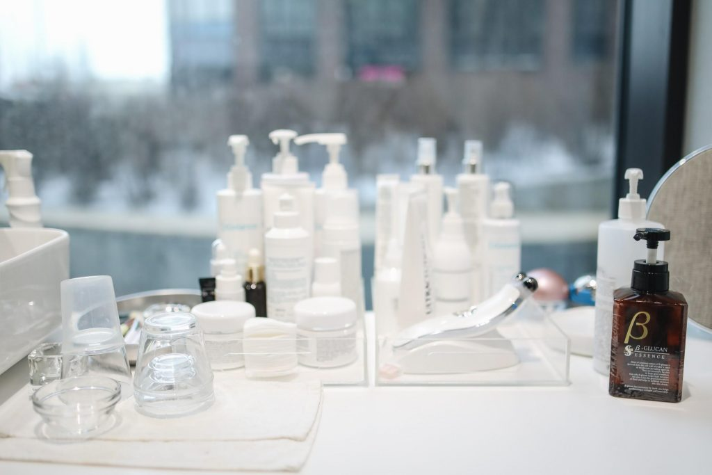 Skincare products arranged on a table (From: Pexels).