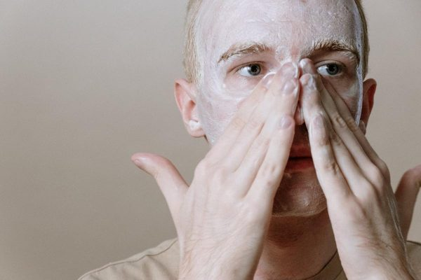 A man using a gentle cleanser on his face. (From: Pexels)