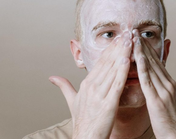 A man using a foaming cleanser on his face. (From: Pexels)